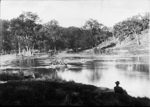 View of Macquarie River. Fishing group in punt - Macquarie River, NSW