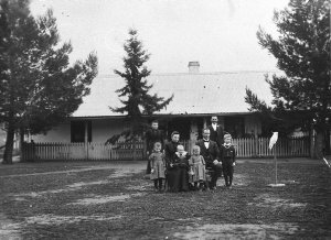 Seated: Anna Elizabeth and Ernst Gottlieb Wenke. Children, L to R: Ester, baby Ludwig, Hilda, Frederick Wenke. Two servants at rear. Sunnyside of mud construction. [See also BCP 00669] - Walla Walla, NSW