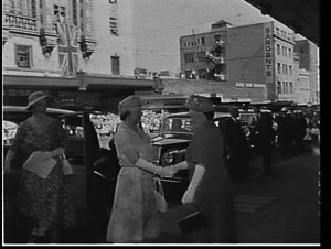 Elizabeth the Queen Mother arriving at the Trocadero for a women's reception