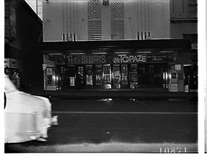 Exterior by day of the Century Theatre advertising the film Mr. Topaze