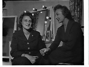 Mrs. Philip Simpson, NSW Society for Crippled Children (?), with Googie Withers in her dressing room