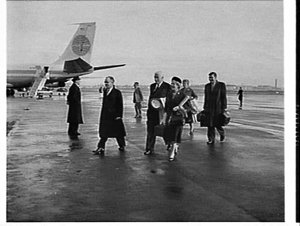 Prime Minister Menzies greeted by Harold Holt on his return from overseas, Mascot