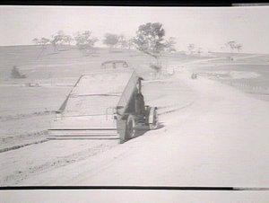 State Highway No. 9. Gravel spreading hopper in operation