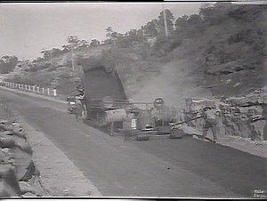 No. 5 Highway. Drag spreader in operation