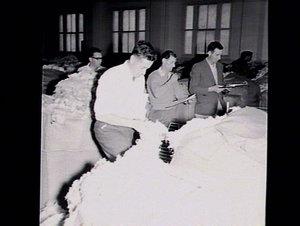 Woolbuyers inspecting wool at Goldsbrough Mort woolstore