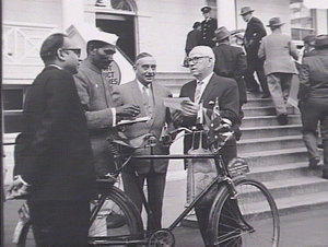 Indian cycle tourist at Parliament House