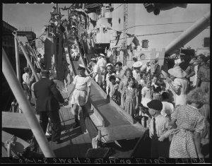 "Xmas Party on HMS ""Howe"", 3 January 1945 / photographs by Ray Olson"