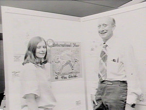 June Hefferan with Director choosing `Child of the Year' poster