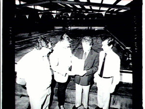 Minister (Mr M.A.Cleary) presenting cheque to Mayor of Randwick (Mr John Scullion) at Heffron Park Swimming Pool