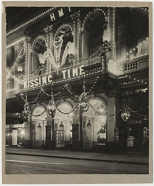 """[Her Majesty's Theatre, Sydney, decorated and illuminated for the visit of the Prince of Wales and showing """"Kissing time"""", 1920]"""