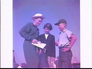 6 mile runner Geoff Warren signs autographs for local children Gail Merrilees and Eddie Grenda, British Empire and Commonwealth Games, 1954, Vancouver