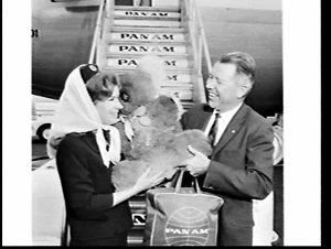 Arrival of American Mr. Rush (Russ ?) Clarke and an unidentified woman on Pan Am Clipper Dauntless, Mascot