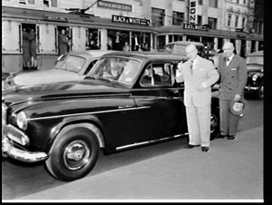 Pianist Jose Iturbi and chauffeur-driven Humber car, Sydney Town Hall