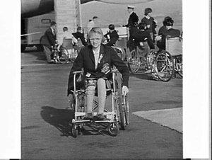 Elizabeth Edmondson returns on BOAC from the International Paraplegic Games 1964 held in Tokyo, Mascot