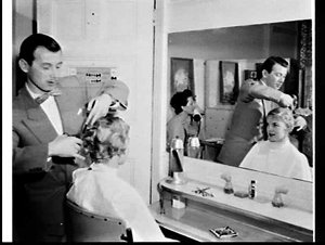 Hairdresser Mr. Stephan cutting a woman's hair, Rex Hotel, Potts Point