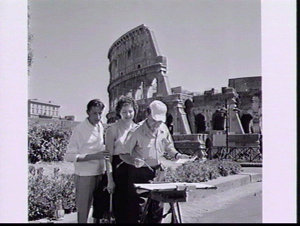 Runner Pat Duggan and her Italian fiance watching an artist at the Colosseum while sightseeing during Rome Olympic Games 1960
