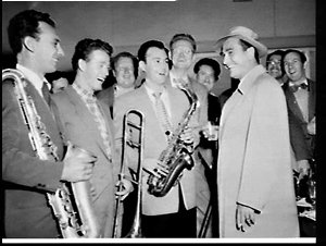Swing band leader Artie Shaw arrives at Mascot