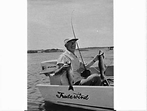 Trout fishing on Lake Eucembene in front of a large Ansett Airlines of NSW flying boat called Beachcomber