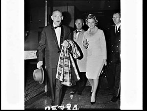 Mr. Tailleur from Holland photographed for Dept. Immigration with the commissionaire, Chevron Hilton Hotel (?)