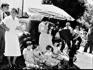 Hopalong Cassidy (William Boyd) visits the children at Strathallan Hospital, Turramurra and Margaret Reid Hospital, St. Ives