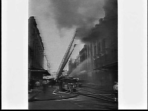 Fire burns out two floors of a building occupied by G.T. McOnie, 357 Sussex Street, Sydney