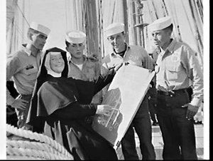 Sister Eunan with Chilean Navy sailors after instructing class from Catholic girls high school on the deck of visiting Chilean Navy training barquentine Esmeralda