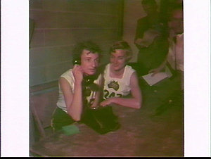 Marjorie Jackson (with Winsome Cripps) on the phone to Australia after the 100 yards race, British Empire and Commonwealth Games, 1954, Vancouver