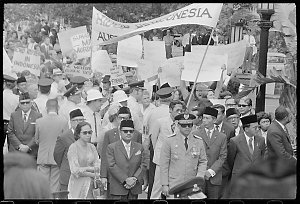 Item 679: Tribune negatives including a welcome parade for the arrival of the Indonesian President Suharto, demonstrators at the welcome parade for the arrival of the Indonesian President, procession calling for the departure of British troops from Ireland, police talking to demonstrators in a park, 1972.
