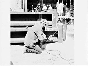 Photographs of builders labourers working on a building commissioned by artist Unk White, Sydney