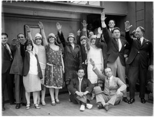 Arrival of Gonsalez Opera Company with hands raised in fascist salute