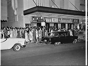 Night exterior of the Century Theatre, 1962, advertising the film The innocents