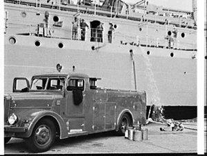 NSW Fire Brigade engine pumps out the boiler room of HMAS Supply, Garden Island