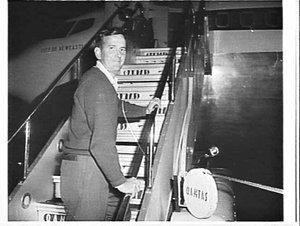 Mr. Hazelton boards Qantas Boeing 707 City of Newcastle, Mascot