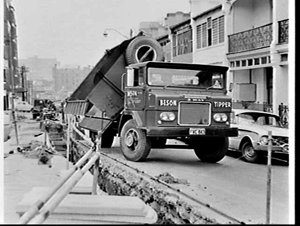 International Muras Beson three way tip truckfilling PMG (?) trenches dug in Sydney roads