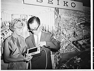 Betty Cuthbert presented with a Seiko watch and inspecting Seiko race-timimg clock, Japan Trade Centre, Sydney