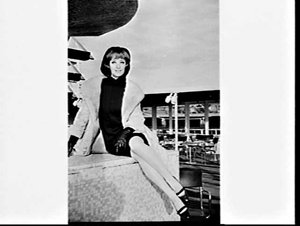 Anna Lengo, Mannequin of the Year, on the deck of the liner Marconi, Circular Quay