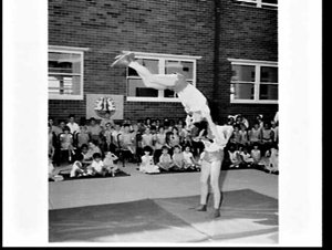 Clowns and acrobats of the visiting Moscow State Circus entertain the children at Far West Home, Manly, at Easter and Easter eggs are given out