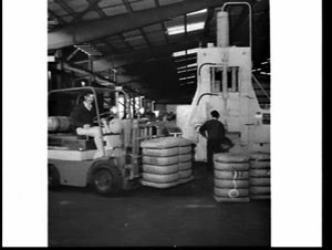 Wool dumping, handling and loading into containers at Wool Dumpers (NSW), Chullora