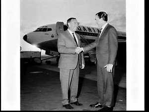 Head of Ford Motor Company (Australia) welcomes the Chairman of Ford, USA, as he arrrives on a Qantas flight, Mascot