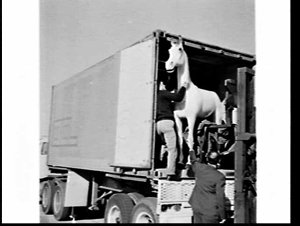 Unloading a life-size model of the White Horse Whisky logo from an Overseas Containers (OCL) container, Mascot