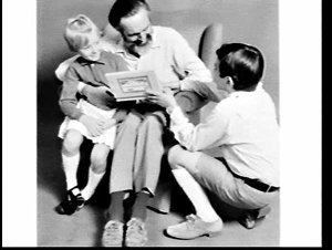 """APA studio advertising photograph of """"father"""" being given a box of Henri Wintermans' cigars by his """"son and daughter"""""""