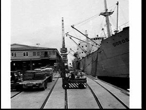 Loading sacks of rice onto the cargo ship Doros, Melbourne