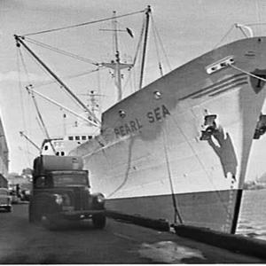 Paper being unloaded from the cargo ship Pearl Sea and stored in a wharf warehouse, Glebe Island