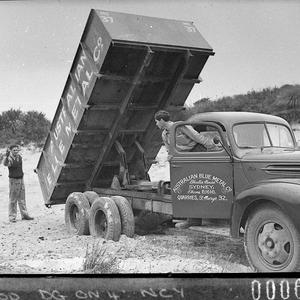 "Truck tipping its load; Australian Blue Metal Co trucks (for Mr Freeman, ""Ford News"")"