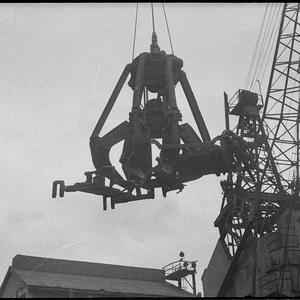 Westwood magnet grab, understood to be the first of its type to operate in Australia, unloads scrap from a ship at B.H.P.
