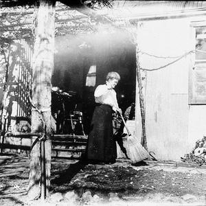 """Mary Rose sweeping at the back of the house under grape vine at """"Meadulegular', Kars Springs - Scone area, NSW"""
