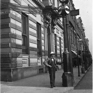 Mick Phelan, the signalman at the signals for use of electric and cable trams, corner King and George Streets, Sydney