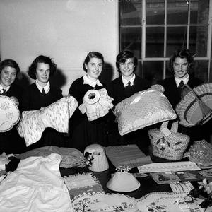 Girls display craft works at the School for the Deaf