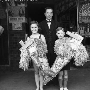 Doreen Beresford and Ronnie Collins with their first and second prize Christmas stockings, Paddington