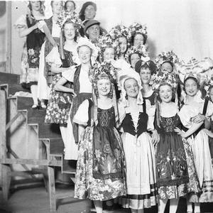 Group of vaudeville or musical artists in back-stage tableau